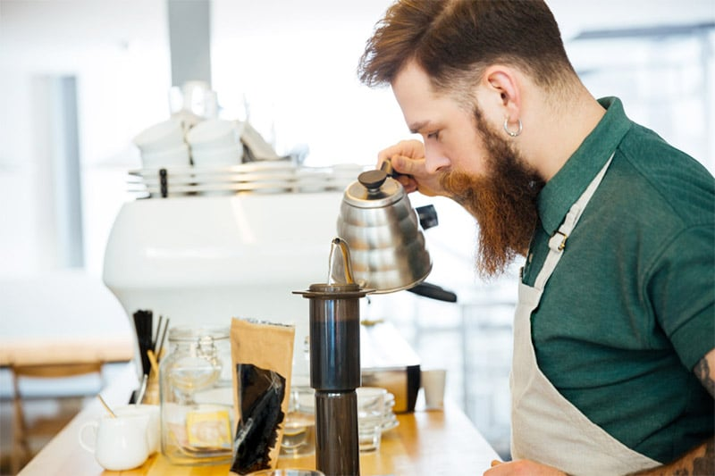 barista using a gooseneck kettle