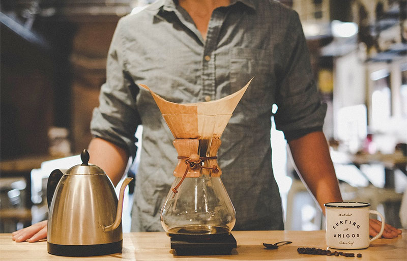 man making chemex coffee